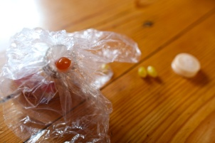 Trying to Extract Jelly Beans, One-at-a-Time, Out of the Useless Bottle Cap, Rim, and Plastic Bag Thingy