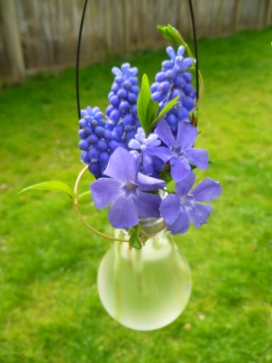 incandescent light bulb vase with spring flowers