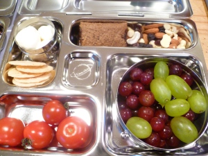 Monday's Lunch: Mozzarella, fruit cookie, trail mix, grapes, home-grown tomatoes, rice crackers. Photo © Rebecca Rockefeller