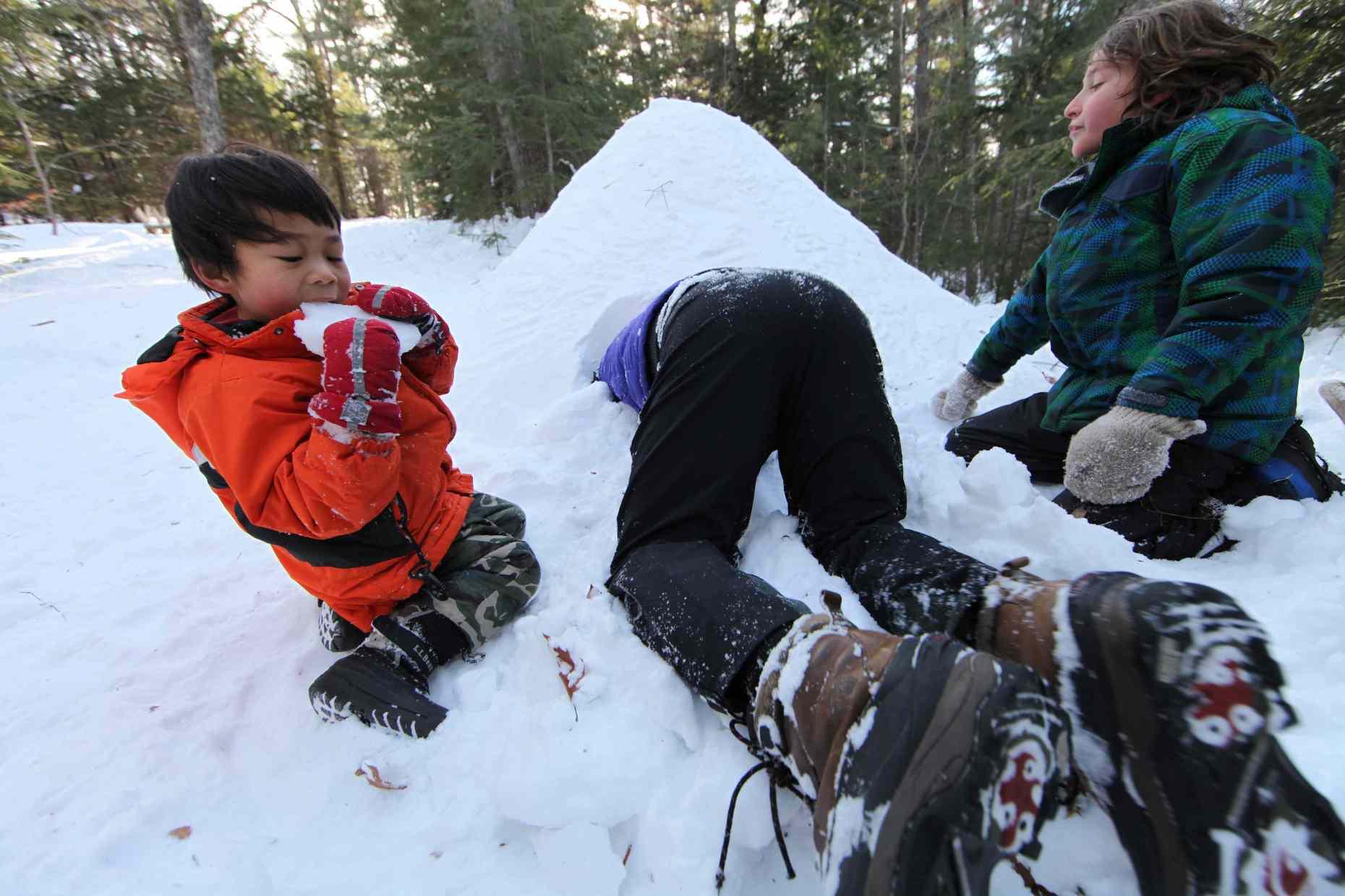 Excavating Snow From the Quinzhee, Photo © Liesl Clark