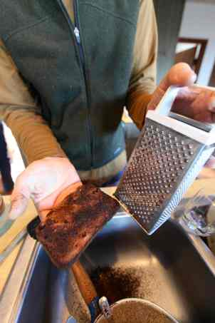 A simple trash hack: Use that cheese grater to scrape off the burnt part of your toast.