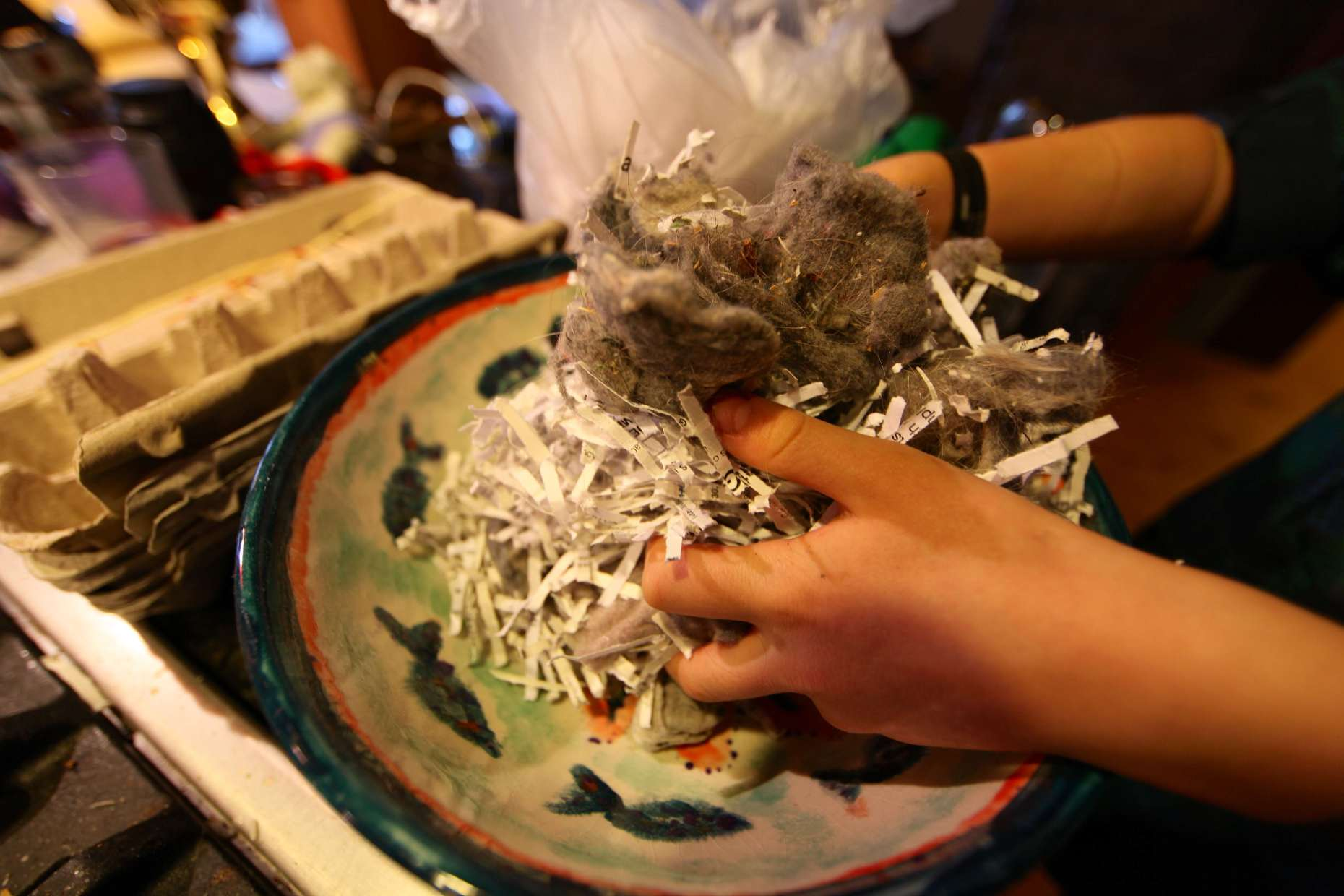 Mix your lint and shredded paper (and saw dust if you have it) together in a big bowl.