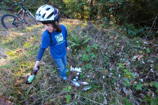 My 9-Year-Old, Picking Up Your Wine and Beer Bottles Next to Our Driveway. Photo © Liesl Clark