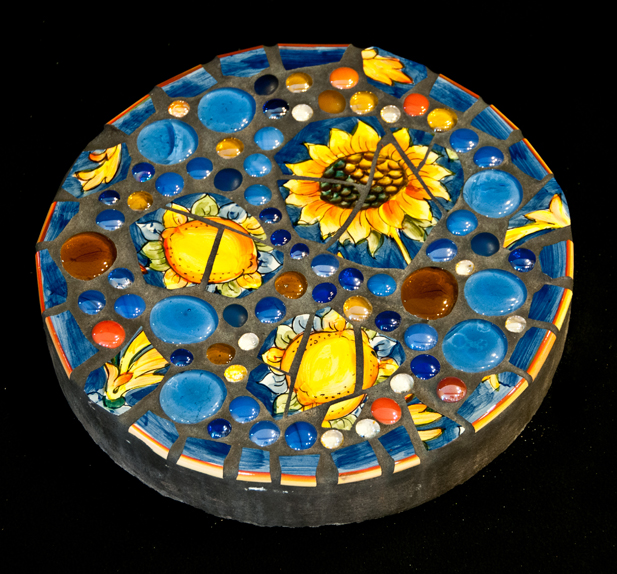 Blue Daisy Stepping Stone:  From a broken serving platter and gems purchased at the Rotary Auction. Photo © Gillian Allard