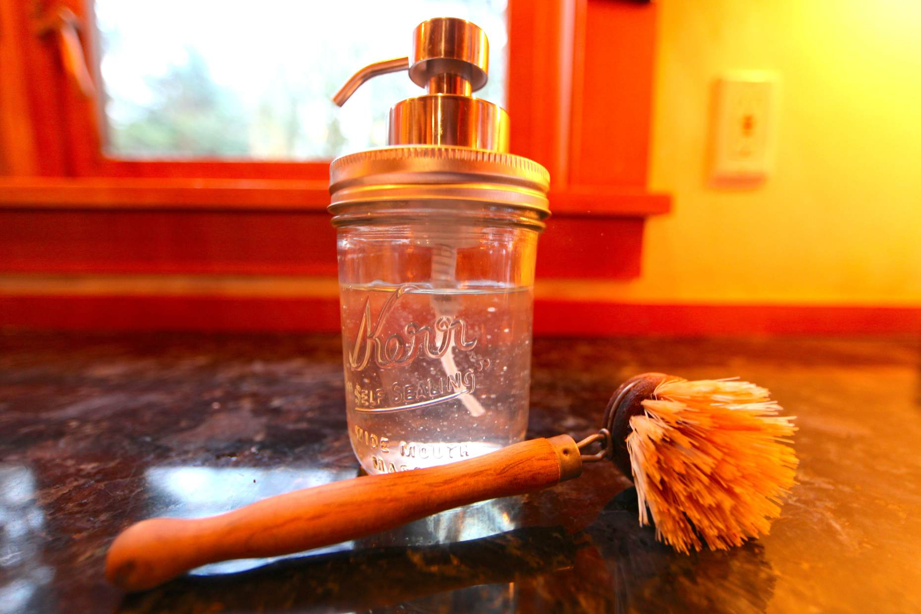 """Our cool new kitchen 'tool:"""" Our DIY soap dispenser. Photo © Liesl Clark"""