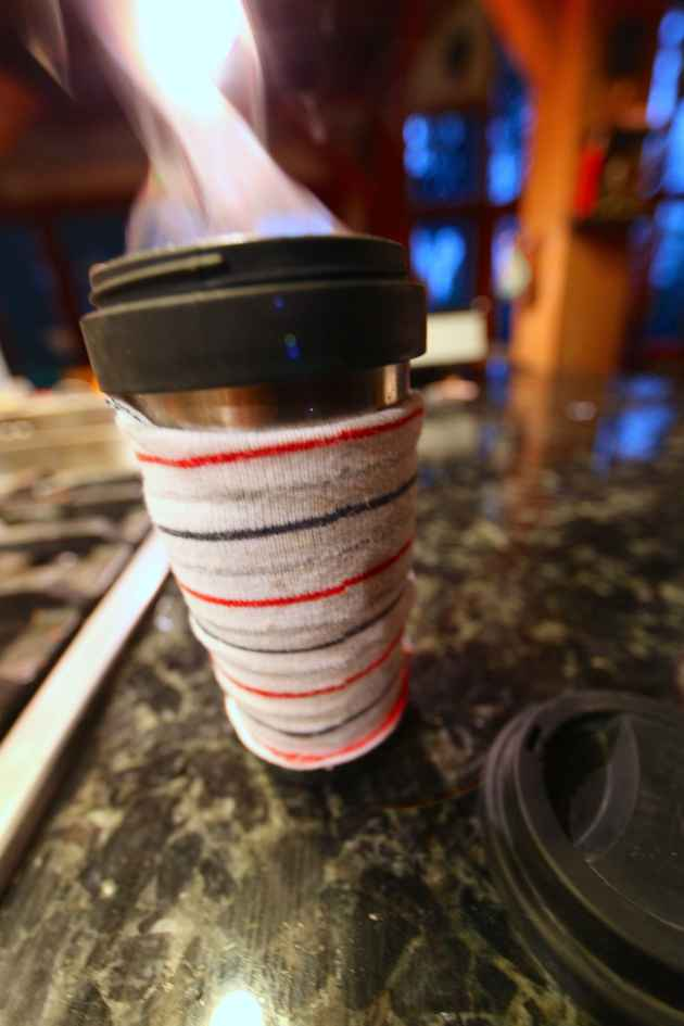 Steaming Travel Coffee Mug With Added Sock Cozy. Photo © Liesl Clark