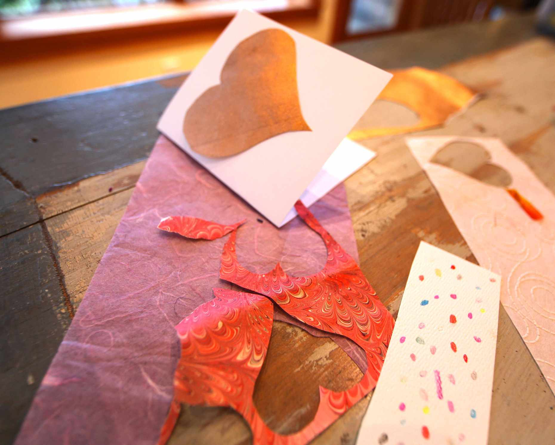 Cutting, folding, and gluing paper is all it takes to make a valentine. Photo © Liesl Clark
