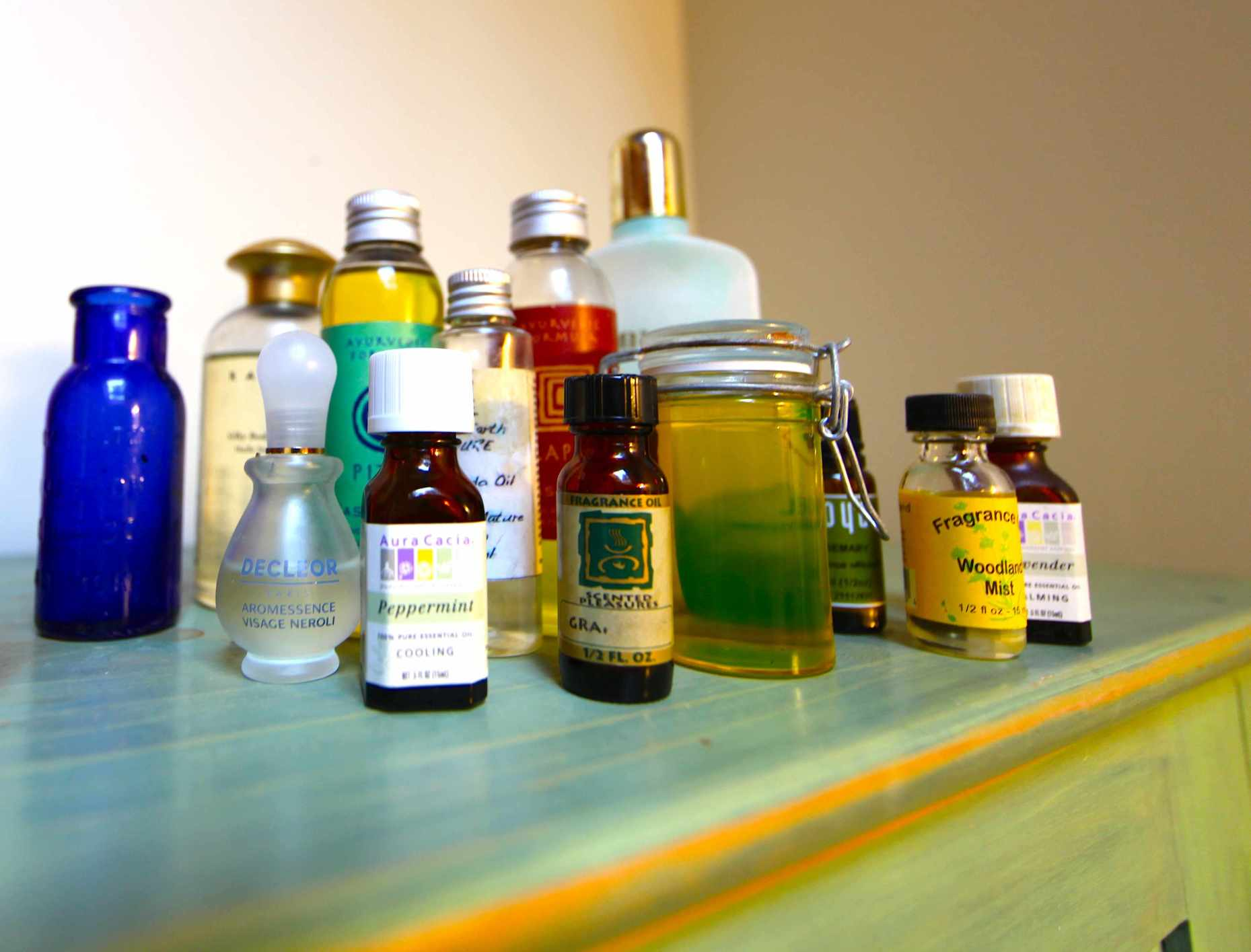Round up your favorite oils to mix with water for a DIY detangler. Photo © Liesl Clark