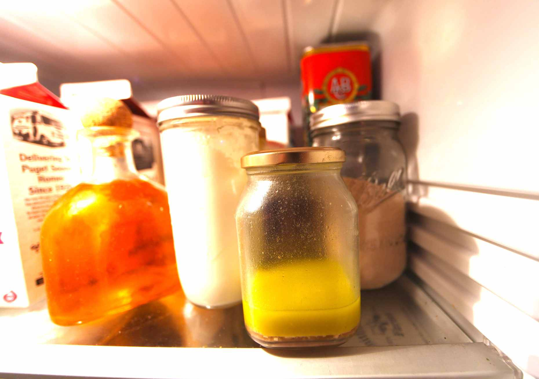 Peek in my fridge and you'll find jars of all shapes and sizes: Patron bottle for flax seed oil, homemade yogurt in a large mason jar, homemade salad dressing in a jam jar and bulk yeast for our bread in another mason jar. Photo © Liesl Clark
