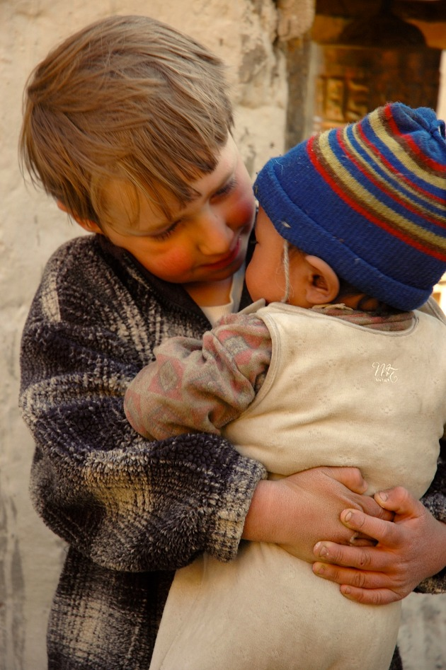 Our son loves passing on his warm hand-me-downs to his friends in Nepal. Photo © Pete Athans