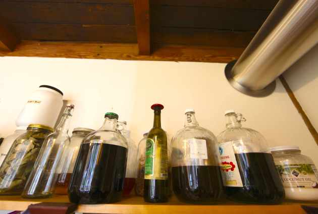 Plastic-Free Bulk Options: Oils & Maple Syrup Stored in Glass. Our Own Honey, too is Stored in Glass. Photo © Liesl Clark