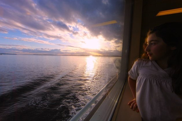 My 7-year-old daughter on a ferry boat ride to our Puget Sound island. Photo © Liesl Clark