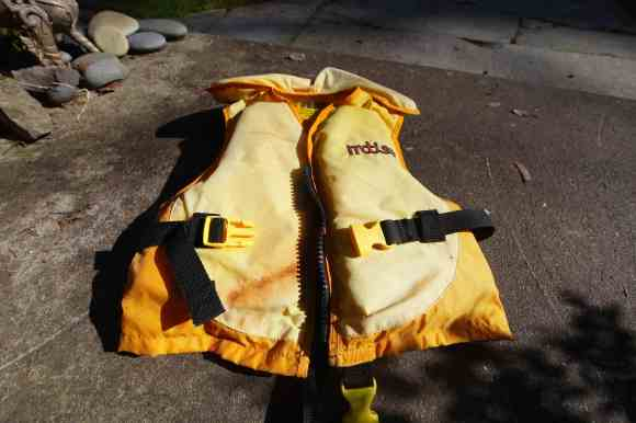 Offloaded this week: A perfectly good child's PFD. We bought it 4 years ago for $70 and are now giving it away for free. It's easy, hassle-free. Photo © Liesl Clark