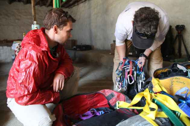 Putting together the rack for a day of cave climbing with Ted Hesser in Upper Mustang, Nepal. Photo © Liesl Clark