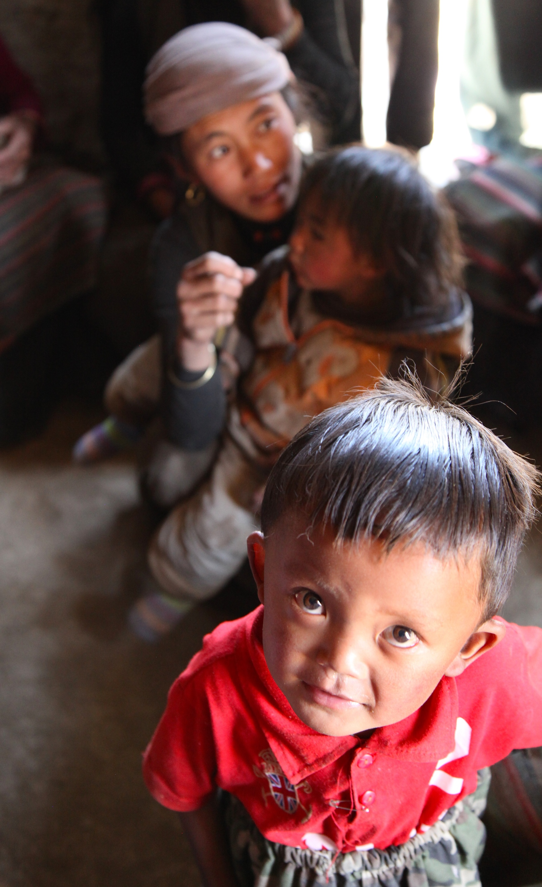A child in Samdzong getting medical care from our expedition doctor. Photo © Liesl Clark