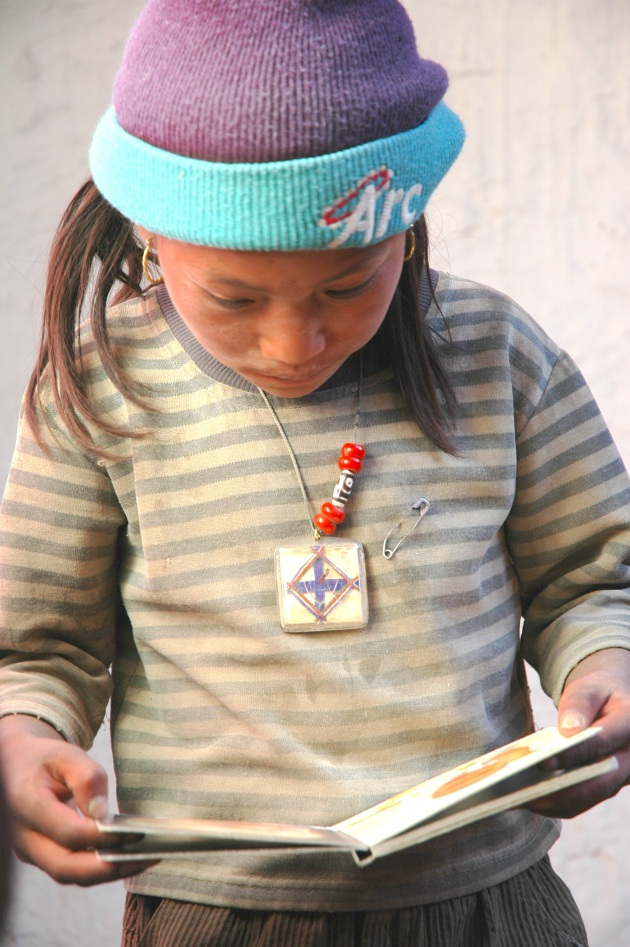 A Tsarang Student Reading Her First Children's Book. Photo © Liesl Clark