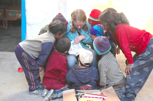 Phoebe Reads to the Tsarang Kids. Photo © Liesl Clark