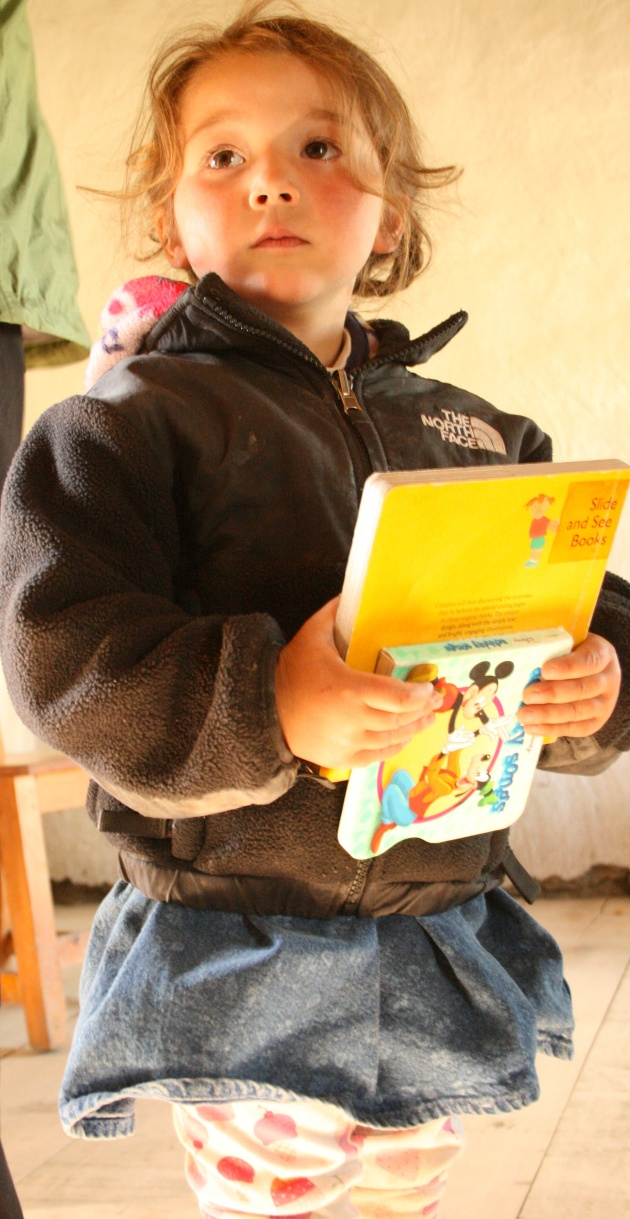 My Daughter, at 2, Donating Her Books to Our Second Magic Yeti Library in Nepal.