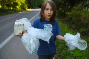 Polyethylene bags can be recycled. These were probably headed toward the recycle bin but ended up on the road and in the bushes.