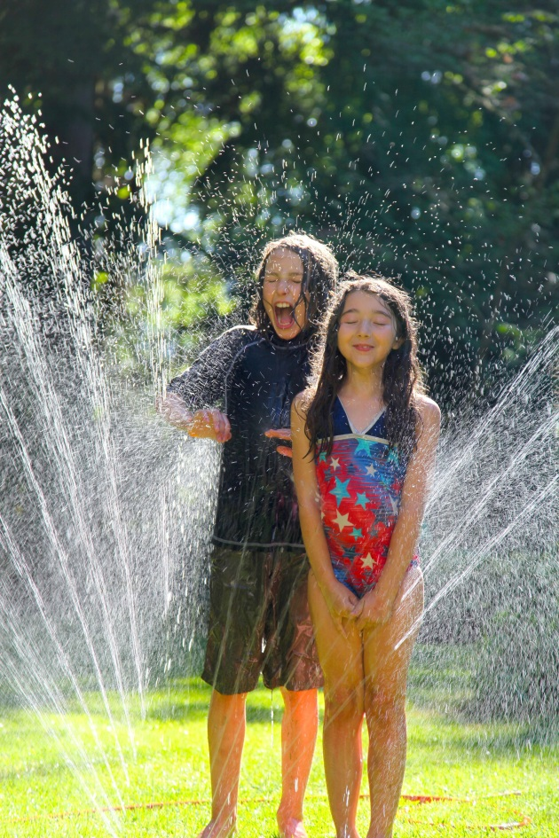 Sprinkler Fun. Photo © Liesl Clark
