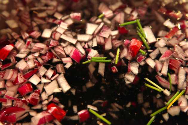 Red onion, chives and garlic with black beans. Photo © Liesl Clark