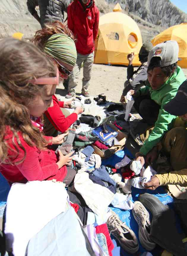 Separating clothing into equal piles for 17 families. © Liesl Clark