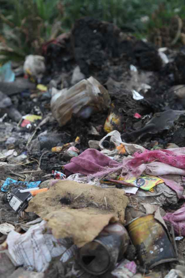 Burning trash is not good for your health or the environment. Plastics emit dioxin which is known to cause upper respiratory as well as neurological problems. © Liesl Clark