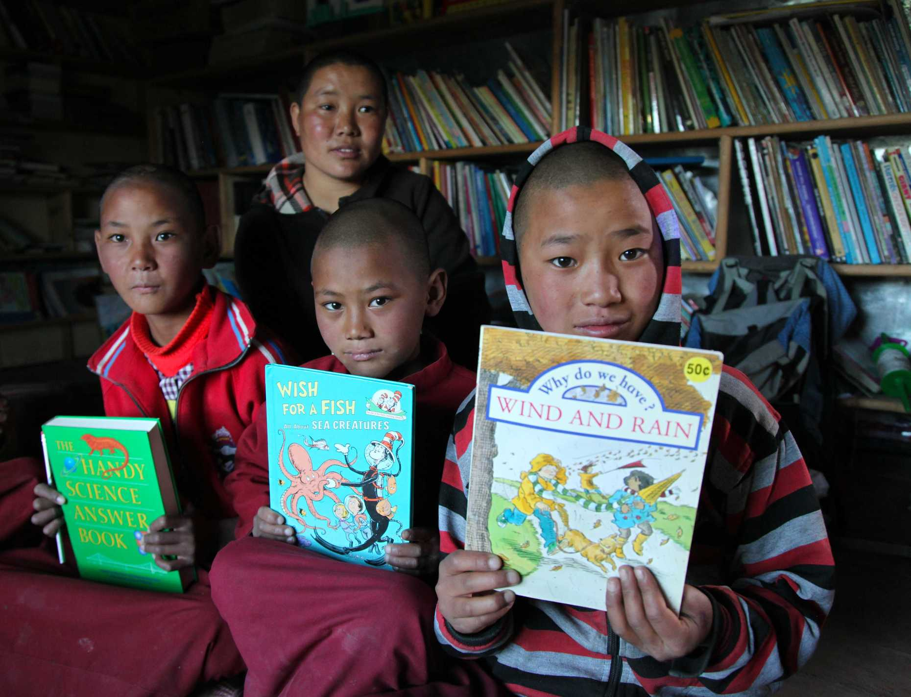 Students at Tsarang's Ani School with books in hand. © Liesl Clark