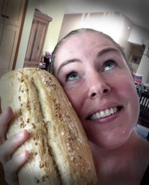 A Buy Nothing Bainbridge member swooning over fresh baked bread she received from a neighbor. © Melisa Lunt