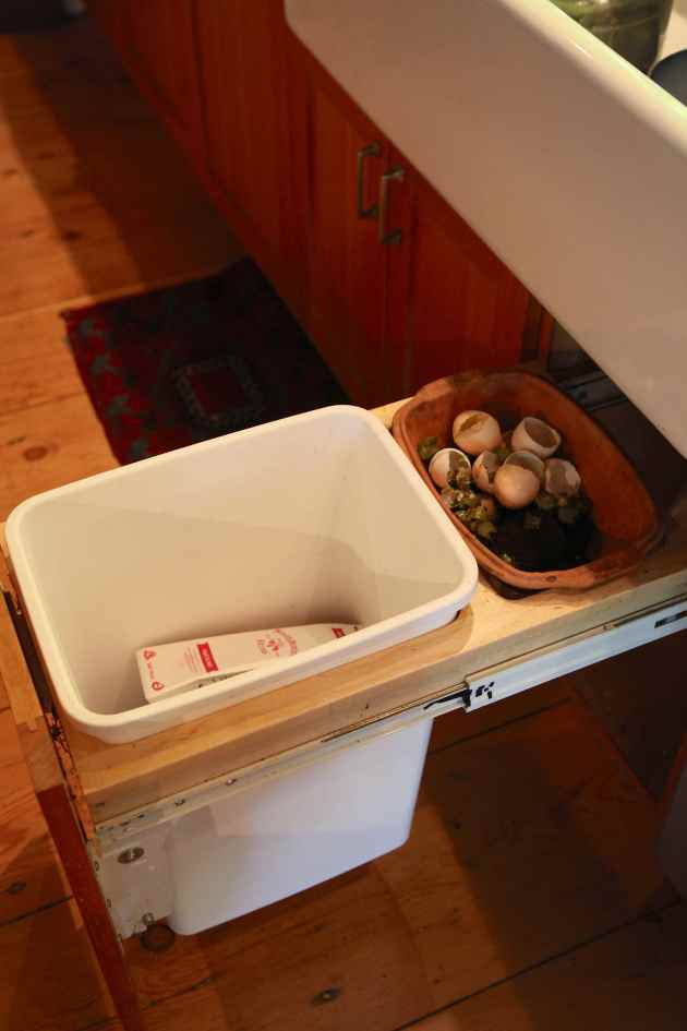 Design your cupboard so you can hide the compost container. © Liesl Clark