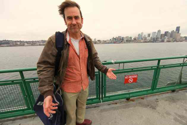 Jeff Wenker on the Bainbridge-Seattle ferry taking warm clothes to homeless men in Seattle. © Liesl Clark